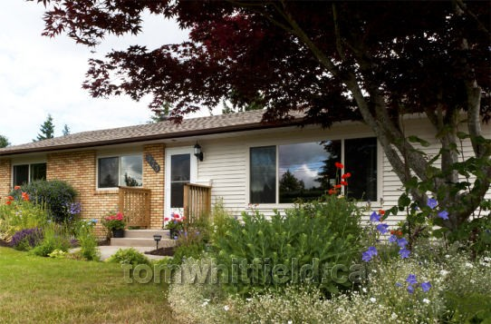 Photo of single family home on Tamarck Drive in Qualicum Beach, BC