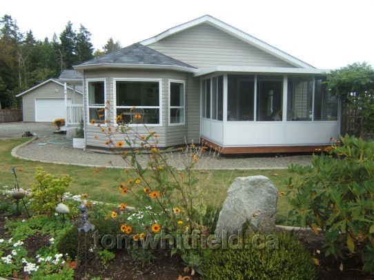 Photo of single family home on Wildwood Road in Qualicum Beach, BC