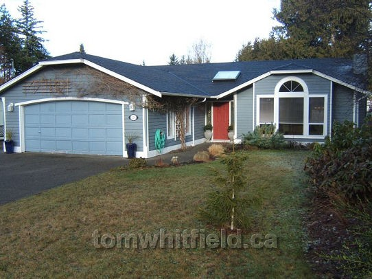 Photo of single family home on Namqua Road in Qualicum Beach, BC